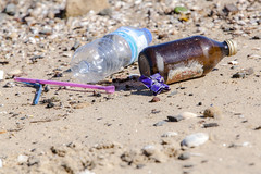 Bottles plastic and glass copyright Rosie Nicolai (Happy days 09) Tags: australia kissingpointpark nsw putney worldcleanupday rosienicolai glass plastic foreshore river cleanuptheworldday straws pink blue parramattariver sand environment