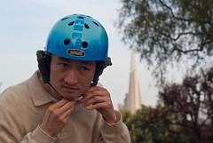 18373 Bike helmet earmuffs version 1, from front while fastening strap (geekstinkbreath) Tags: sanfrancisco me helmet yarn earmuffs russianhill earmuff bikehelmet bicyclehelmet earwarmers earwarmer minolta50mm nutcasehelmet nutcasehelmets