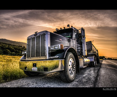 optimus prime's evening resting spot | emerald lake, ca (elmofoto) Tags: road sunset tractor reflection photoshop truck emblem landscape power diesel fav50 muscle cab wheels perspective dumptruck headlights fav20 chrome adobe rig barbedwire trailer heavyequipment fav30 hdr highdynamicrange pf peterbilt optimusprime lightroom hittheroad fav10 photomatix fav100 tonemapping fav40 5000v fav60 fav90 fav80 fav70 flickraward 1424mm flickraward5 flickrawardgallery elmofoto lorenzomontezemolo forcurators