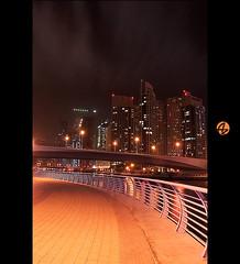 Dubai City Skyscrapers (Az. Abdulrahman Alzahim) Tags: sky white black clouds canon buildings reflections photography 1 nikon dubai raw photographer photos az architectural abstraction effect hdr santo photographe darknes xiii awesomeshot