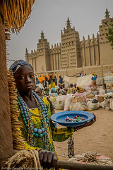 little seller little seller with the background the large mud mosque at Djenne market, sahel, mali (anthony pappone photography) Tags: africa travel girl niger canon child mud great mosque westafrica afrika mali ethnic afrique sahel moschea   mudmosque  childrentravel portraitsofchildren djenn     africantribe    mygearandme