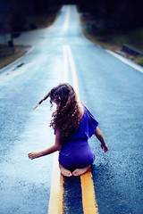 (Noelle Buske) Tags: road blue motion girl dark hair nikon sitting dof dress move curly cooltones d40