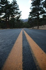 Driving through the Rocky Mountains. (BuzzFarmers) Tags: road street travel marketing blog tunnel roadtrip creativecommons rockymountains estespark longroad rockymountainnationalpark lightattheendofthetunnel theroadlesstraveled theroadlesstravelled buzzfarmers