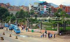 Ganesh Man Singh Park ( Jamie Mitchell) Tags: poverty road street nepal woman dog man colour asian reading asia homeless culture kathmandu policeman singh