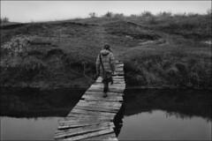 Through a planked footway of the river of Beriozovaya (misha maslennikov) Tags: bw film f3 nikon maslennikov don steep senshin otherrussia russia