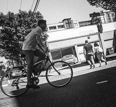 How We Move (TMimages PDX) Tags: iphoneography photography image photo photograph streetscene fineartphotography geotagged people urban city street streetphotography portland pacificnorthwest sidewalk pedestrians buildings avenue road blackandwhite monochrome vignette bike bicycle vehicle