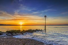 First Meteorological Sunrise Of Autumn (nicklucas2) Tags: avonbeach dorset seascape beach groyne sand sea seaside solent sun sunrise water cloud