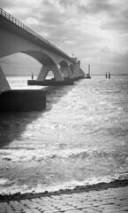 Longitude (Arne Kuilman) Tags: akarette xenon 50mm lens ilford xp2 nederland netherlands handheld c41 zeeland zeelandbrug zierikzee brug boot boat schneiderkreuznach xenon50mmf2