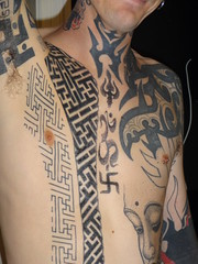 Body swastikas on an advocate of Learn to Love The Swastika Day, Copenhagen, Denmark (CultureWise) Tags: swastika tattoo symbols bodyart
