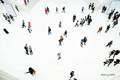 Purposely Random (Dave G Kelly) Tags: crowd people lookingdown elevatedview whitebackground walking