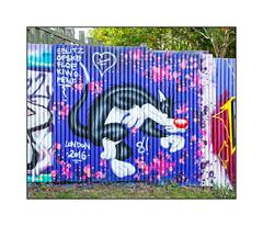 Street Art (Various), North London, England. (Joseph O'Malley64) Tags: eblitz ofske floe kiwo ment graffiti streetart northlondon london england uk britain british greatbritain sylvester cartooncharacter woodenfencingpanels fence ashtree grass mural muralist muralists aerosol cans spray paint