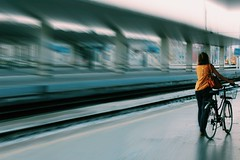 Emotion (Santina Morciano) Tags: train railway station stazione treno attesa waiting colours colori panning movimento motion emotions ride bike walking lovers italy italia florence firenze italiana italian camminare passeggiare promenade