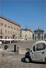 Small car for narow streets of Italy (Stefan Cioata) Tags: summer italy tourism beautiful car square photography photo italia place image sale small great stock tourist best explore mantova getty destination piazza top10 available outstanding vehicule narow terace sordello touristical