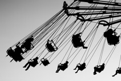 The Best of Times (Thomas Hawk) Tags: california bw usa silhouette unitedstates fav50 10 statefair unitedstatesofamerica fair fav20 sacramento fav30 sacramentocounty californiastatefair fav10 chairoplanes fav25 swingcarousel fav40 superfave californiaexpositionstatefair