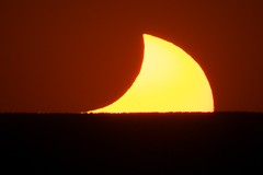 Eclipsing Moon and Sun Setting on Mt. Taylor, May 20 2012 (SuperSnappy) Tags: new sunset orange sun mountain distortion newmexico color yellow lens mexico fire star solar eclipse unique altitude pass may shapes atmosphere albuquerque peak ring stellar pacman abq 20 nm shape disc setting sunspot atmospheric twenty 20th sandia 2012 annulus ringoffire lensing twentieth eclipsed annular 1479 eclipsing 1482 1484 1486 1483 1478 1000mmf11celestron