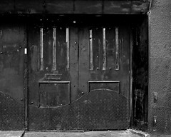 black doors (Harry Halibut) Tags: black doors fuel nightclub eyre street sheffield fire exit entrance decrepit decay kick plate curved sheff1205201647a 2012andrewpettigrew imagesofsheffield images allrightsreserved contrastbysoftwarelaziness noiretblac blackwhite blancoynegro blanc weiss noire schwatz bw zwart wit bianco nero branco preto