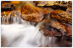 Water Cascade 4 (param_s) Tags: park motion mountains nature water rock canon landscape flow gold golden waterfall warm great parks boulder sparkle boulders national edge jagged flowing smoky streaks cascade 1740 greatsmokymountainsnationalpark showshutter 60d