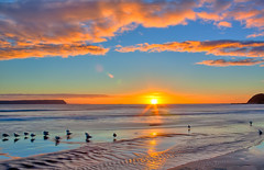 As The Sun Goes Down... (Ankit_) Tags: longexposure newzealand sky seascape beach nature canon landscape bay coast rocks flickr nz wellington redrocks northisland coastline southcoast hdr cpl plimmerton topaz porirua nd8 eos450d 1855kitlens 450d ihdr