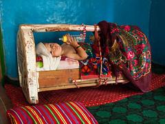 Pamiri baby (Evgeni Zotov) Tags: people baby house color colour home bed colorful nipple village child colourful tajikistan tajik cradle pamir teat pamirs tayikistn nisar tadschikistan tagikistan pamiri bartang   nisur tadzjikistan tajiquisto tadykistan tadsjikistan tacikistan