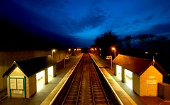 Waiting (Serge Freeman) Tags: uk station wales lights evening twilight railway symmetry