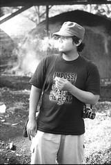 smokey enough? (asuramaru™) Tags: friends people film 50mm gold minolta kodak 200 malaysia analogue 2012 kelantan x700 rokkor bachok charcoalfactory ƒ17 bekelam localsmallindustry