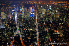 Gotham Nights (TIA International Photography) Tags: road park street new york city nyc bridge urban building apple electric skyline night america tia river square landscape real grid corporate office spring big downtown cityscape estate view skysc