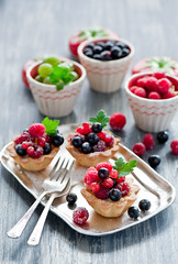 small tarts with cream and fresh berries (The Little Squirrel) Tags: red black baking berry small fresh tarts gooseberry rasberry currant