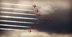 in formation....Explored (niknok2007...) Tags: redarrows red arrows plane jet sky clouds cloud smoke trails formation 9ship raf scampton lincolnshire niknok2007 nicolaratcliffe nicolaratcliffephotography atmospheric light dark