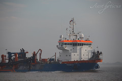 Ship at work (Foto-Aestheticus) Tags: ship boat harbor harbour outside outdoor sea water sky black orange neon white flag flags rope foggy fog light sunlight summer bremerhaven germany atwork menatwork blue wave canon