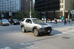 Fangs (Flint Foto Factory) Tags: chicago illinois urban city summer august 2016 friday downtown loop jackson dearborn intersection 1999 2000 2001 isuzu vehicross suv japanese import trooper based moving motion inmotion evening afternoon rushhour traffic pm front threequarter view grille fangs worldcars