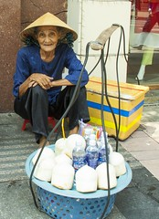 Coconuts And Water For Sale (SAM601601) Tags: sam601601 woman coconut water hochiminhcity saigon vietnam seller