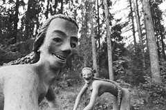is it creepy? (Ilona Fogelson) Tags: photo film finland suomi summer analog analogphotography 35mm statue parikkala patsaspuisto park sculpture bw blackandwhite agfa agfaapx400 canon canonef24105 canon24105 canoneos300 canonrebel2000 negative nature forest
