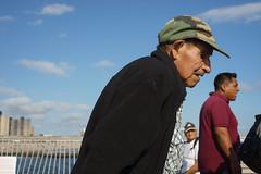 Hunch (dtanist) Tags: nyc newyork newyorkcity new york city sony a7 contax zeiss carlzeiss carl planar 45mm brooklyn coney island boardwalk steeplechase pier hunch hunched back elderly man walking