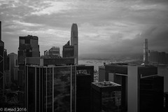 Life in Motion - Cloudy afternoon... (EHA73) Tags: summicronm1228asph leica leicamm typ246 hongkong cloudy victoriaharbor monochrome bw travel blackandwhite cityscape skyline urban modern architecture ifc lippo towers skyscrapers harbor