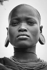 Suri Woman, Ethiopia (Rod Waddington) Tags: africa african afrika afrique ethiopia ethiopian ethnic etiopia ethnicity ethiopie etiopian thiopien suri traditional tribe tribal omo omovalley outdoor blackandwhite monochrome woman female earplug portrait people