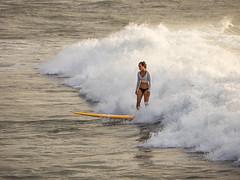 Surfer, North Shore, Oahu, Hawaii (Jon Wojan) Tags: surfer surf surfing waves ocean northshore pacific olympus omd em1 omdem1 ocano sport sports mar surfergirl human woman surfboard rider swell spray turtlebay tropic tropics tropical vacation