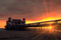 Weston Sunset (martinturner) Tags: new light sunset sea holiday beach fire lights pier seaside sand neon mare shadows grand somerset super flare burst weston rebuilt wsm martinturner