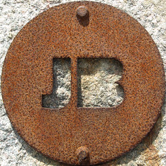 JB (chrisinplymouth) Tags: uk england sculpture art sign metal cutout circle rust iron unitedkingdom steel letters rusty plymouth plate devon round oxidation squaredcircle rusting jb squircle alphabet disc corrosion mountbatten corroded doublet twoletter cw69x chrisinplymouth nauticaltelegraphcode