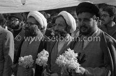 Iran - 08/02/1979/ - demonstration to support Medhi Bazargan , in the streets of tehran, seven days after the arrival of Khomeyni /// manifestation de soutien a Medhi Bazargan , sept jours apres l arrivee de Khomeyni a Teheran   /// IRAN25308 38 (setboun photos) Tags: asia iran muslim islam religion histoire historical asie tehran centralasia 1979 mullah clergy musulman cleric pretre asiecentrale clerge mullahs mollahs chiite mollah whiteturban iranianrevolution1979 religionmusulmane iranhistory islamshia chiisme politicalandsocialissue evenementhistorique muhamaddescendant turbanblanc fleursymbolique islampolitic mullahswithflower religieuxavecdesfleurs