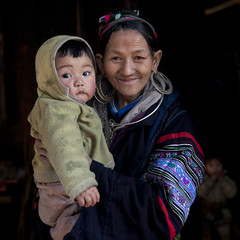 Black Hmong Grandmother With Her Grandson In The Arms, Sapa, Vietnam (Eric Lafforgue) Tags: two people baby childhood youth square person togetherness kid asia grandmother interior tribal vietnam grandson together innocence earrings tribe twopeople humanbeing sapa hmong traditionaldress colorphoto blackhmong ethnicminority northernvietnam 6270 lookingatcamera traditionalclothes reddao twopersons waistup reddzao ethnicgroup daopeople mongdu
