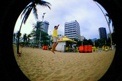 Slack Line (DanielRocha021) Tags: blue boy brazil sky sun film sol praia beach sports colors yellow brasil riodejaneiro cores lomography rj areia cu fisheye filme
