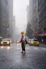 When it rains... (arunkumar.b) Tags: city nyc newyorkcity summer people woman usa ny newyork beautiful rain weather yellow lady dof taxi awesome taxis depthoffield unionsquare downpour taxicabs