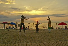 the stilt dancer's sunset (uteart) Tags: ocean sunset reflection clouds mexico bahiadebanderas puertovallarta stilts goldenhour rainyseason stiltdancers amapas losmuertosbeach utehagen uteart
