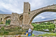 Fishing under the bridge / Pescando bajo el puente.- (ancama_99(toni)) Tags: pictures old bridge sky people espaa color history water arquitetura architecture photoshop geotagged puente photography photo spain arquitectura agua nikon espanha europa europe arch foto gente photos antique decay arc picture photographic catalonia medieval girona tokina human fotos architektur pont catalunya fotografia espagne arco aigua catalua humans spanien spagna gerona 2012 pasoscatalans besalu fotografa fotografas katalonien besal catalogne 10favs 10faves holidaysvacanzeurlaub 1116mm ancama99 d7000