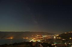 Think about time (n.pantazis) Tags: longexposure night stars nightshot streetlamps trails greece galaxy moonlight nightphoto andros cartrails ormos ormoskorthiou aegeanseawideangle