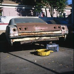 Empty socket Chevy (ADMurr) Tags: la dtla chevrolet impala rust oil pan empty light sockets rolleiflex fuji chrome slide film 2015
