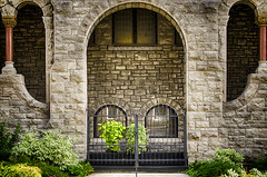 Uninvited (flashfix) Tags: august232016 2016 2016inphotos nikond7000 nikon ottawa ontario canada 40mm curves archway fence garden architecture lines brick building church greenery downtown windows
