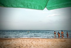 Let's Go Swimmg Instead! (Yassine Abbadi) Tags: tetouan tetuan morocco maroc cabo negro cabonegro sea mediterranean sand umbrella kids sky afternoon cloud