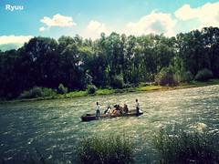 "rafting along the river ""Dunajec"" [explored] (Ryuu) Tags: river raft rafters rafring tourists people swimming candid turquoise water riverbank green trees blue sky white clouds freshair vignette silhouettes rafter bushes rushes nature composition sunny waves"