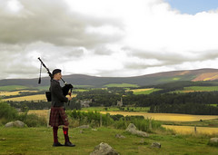 57 of 100 - Lone Piper (linlaw39) Tags: bagpiper bagpipes scotland sky stonecircle tomnaveriestonecircle project100 image57100 aberdeenshire august2016 20082016 canonpowershotsx60hs countryside landscape